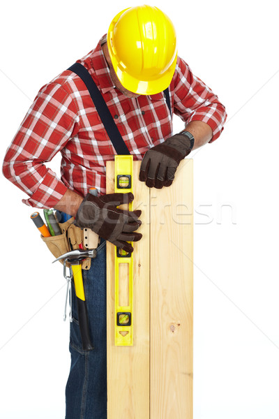 Hands of worker with wooden plank and ruler. Stock photo © Kurhan