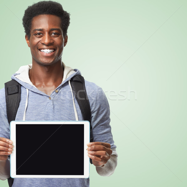 Afro american man with tablet computer. Stock photo © Kurhan