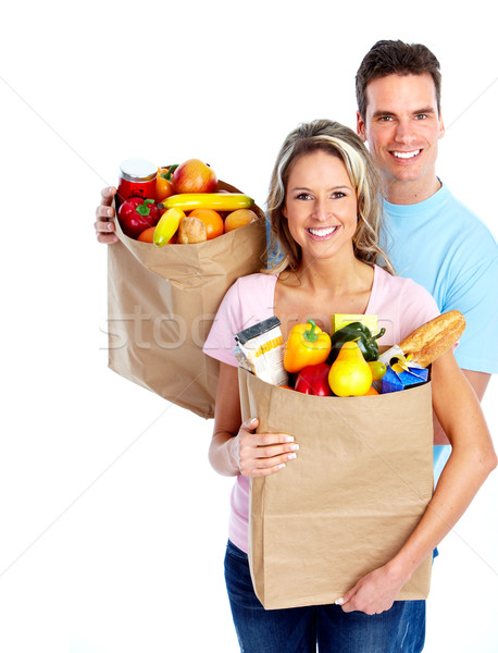 Young couple with a grocery shopping bag. Stock photo © Kurhan