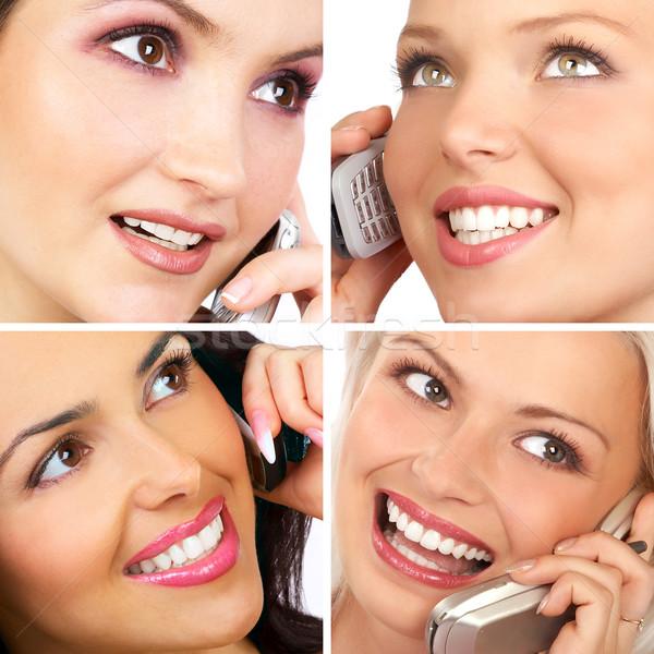 Femmes cellulaires séduisant jeunes femmes appelant téléphone cellulaire Photo stock © Kurhan