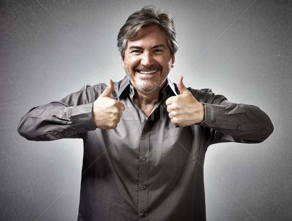 Gelukkig man opgewonden blij succes Stockfoto © Kurhan
