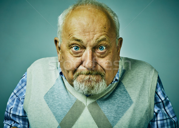 Angry disgruntled senior man face expression. Stock photo © Kurhan