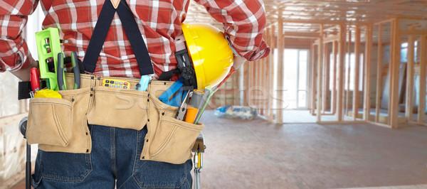 Builder with construction tools. Stock photo © Kurhan