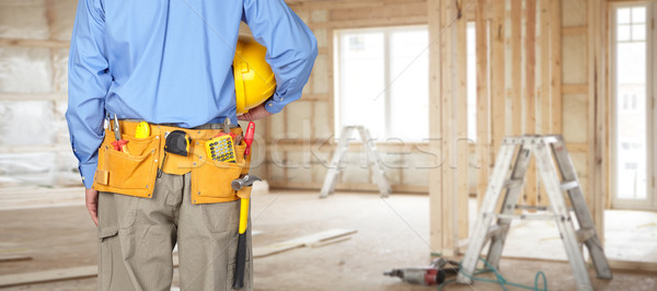 Construction worker with a tool belt. Stock photo © Kurhan