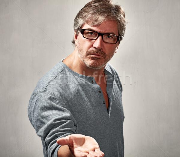 Hebzuchtig man volwassen man portret grijs sepia Stockfoto © Kurhan