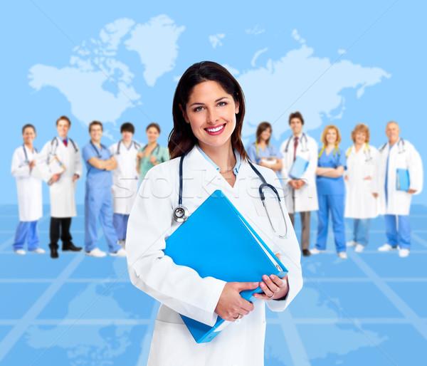 Doctor woman with a medical team. Health care. Stock photo © Kurhan