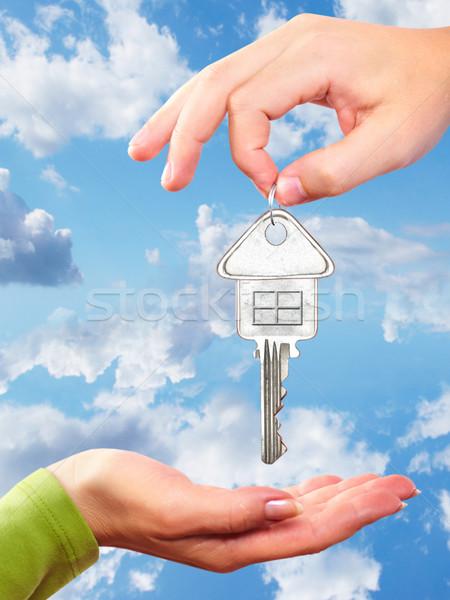 Hand with a home key. Stock photo © Kurhan