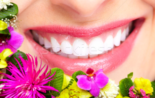 Beautiful woman teeth and smile. Stock photo © Kurhan