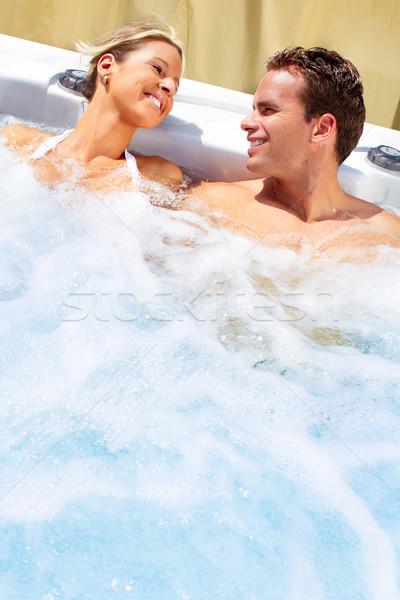 Feliz casal jacuzzi relaxante banheira de hidromassagem férias Foto stock © Kurhan