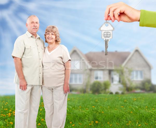 Senior couple near new home. Stock photo © Kurhan