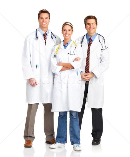 Orvosok mosolyog orvosi emberek nővérek fehér Stock fotó © Kurhan