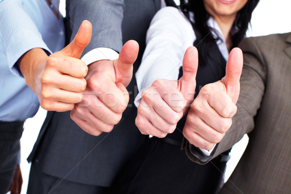 Hands of business people with thumbs. Stock photo © Kurhan