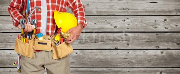 配管 手 ヘルメット 給水栓 木製 男 ストックフォト © Kurhan