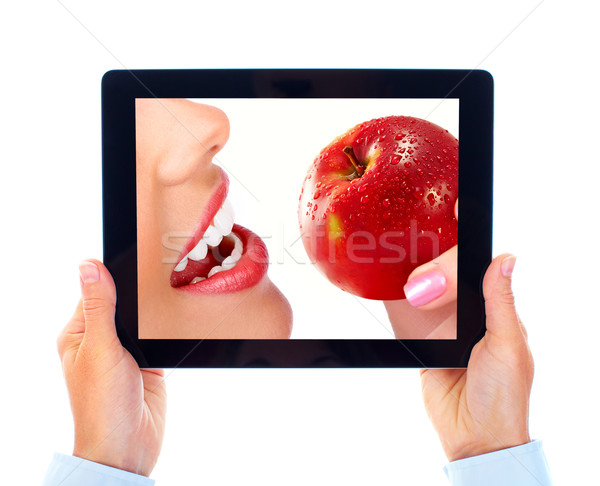 Tablet computer and woman with apple Stock photo © Kurhan