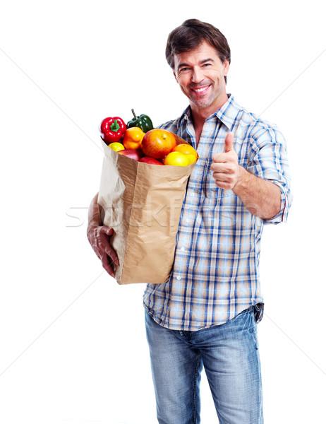 Férfi élelmiszer táska izolált fehér boldog Stock fotó © Kurhan