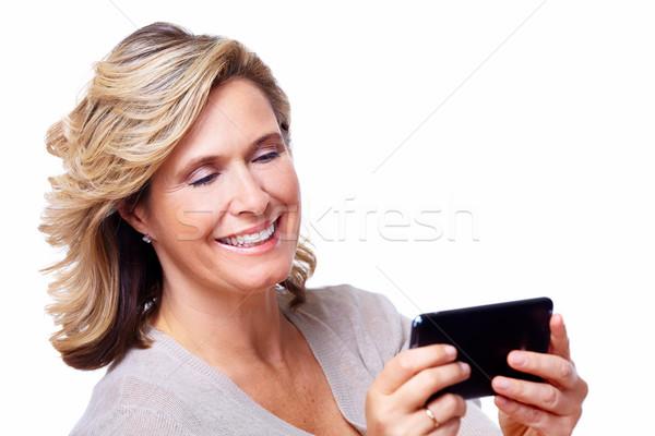 Happy senior woman with tablet computer. Stock photo © Kurhan