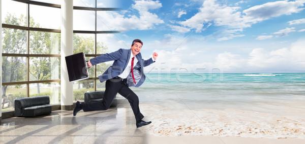 Happy Man running on the beach. Stock photo © Kurhan
