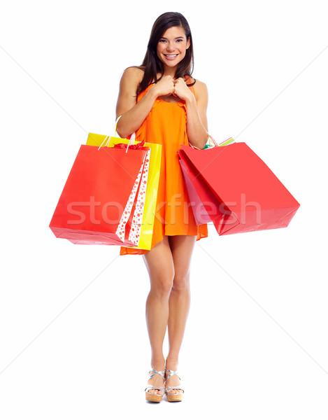Gelukkig winkelen meisje zakken geïsoleerd witte Stockfoto © Kurhan