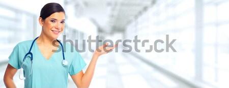 Nurse presenting a copy space. Stock photo © Kurhan