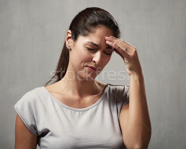 Woman headache Stock photo © Kurhan