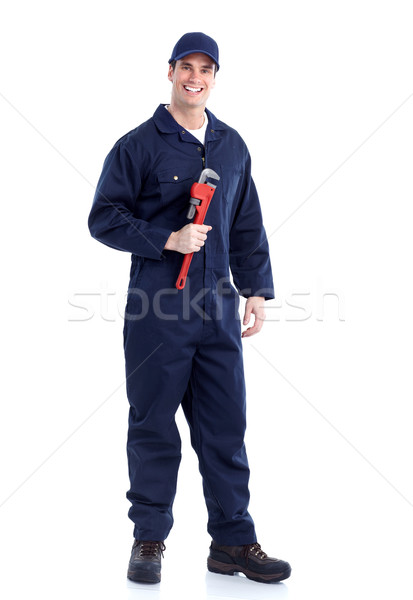 Plumber with an adjustable wrench. Stock photo © Kurhan