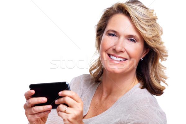 Happy senior woman with a smartphone. Stock photo © Kurhan