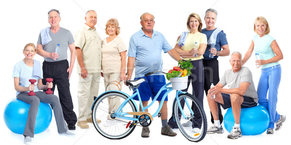 Group of elderly fitness people with bicycle. Stock photo © Kurhan