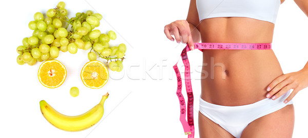 Woman waist with measuring tape over white background. Stock photo © Kurhan