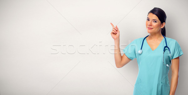 Doctor woman showing advertising space. Stock photo © Kurhan