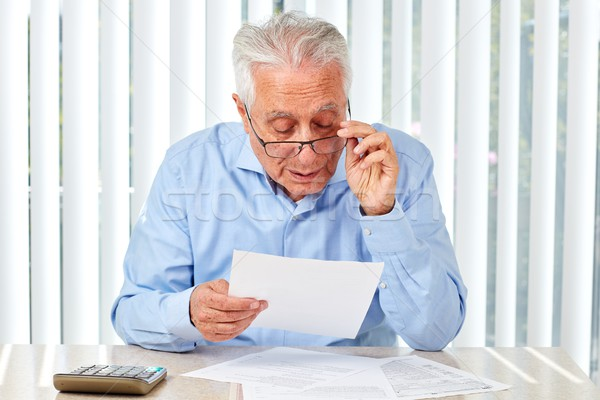 Stock photo: Elderly man with papers.