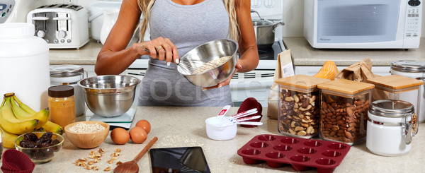 Woman hands cooking gluten free recipe. Stock photo © Kurhan
