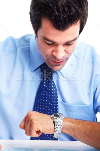Сток-фото: бизнесмен · красивый · глядя · время · изолированный · белый