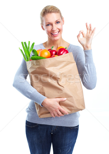 Young woman with a grocery shopping bag. Stock photo © Kurhan