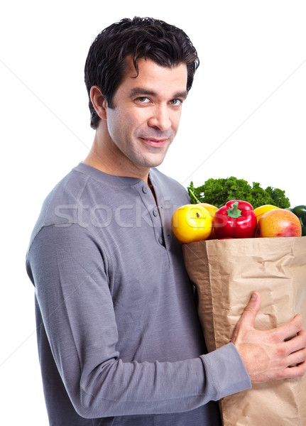 Man with a grocery shopping bag. Stock photo © Kurhan