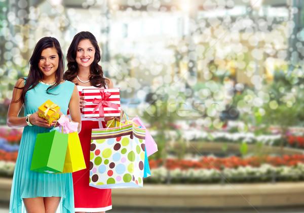 Young woman with shopping bags. Stock photo © Kurhan