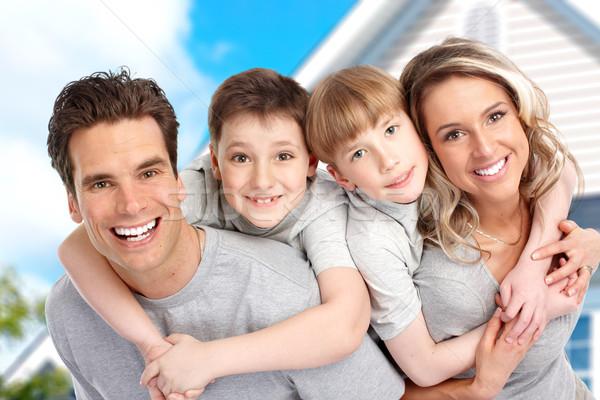 Fiatal család új otthon ingatlan nő égbolt Stock fotó © Kurhan