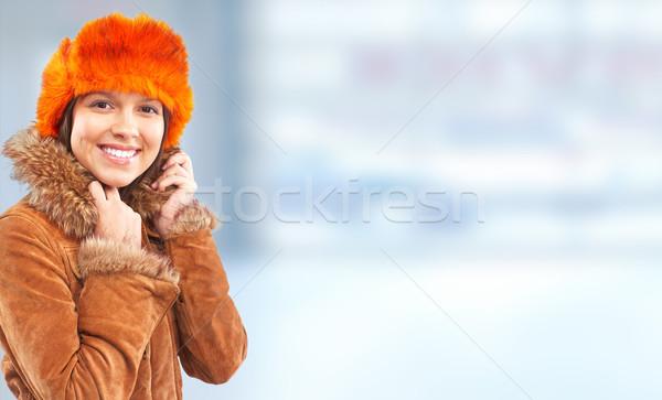Genç kadın kış kat afiş kadın Stok fotoğraf © Kurhan