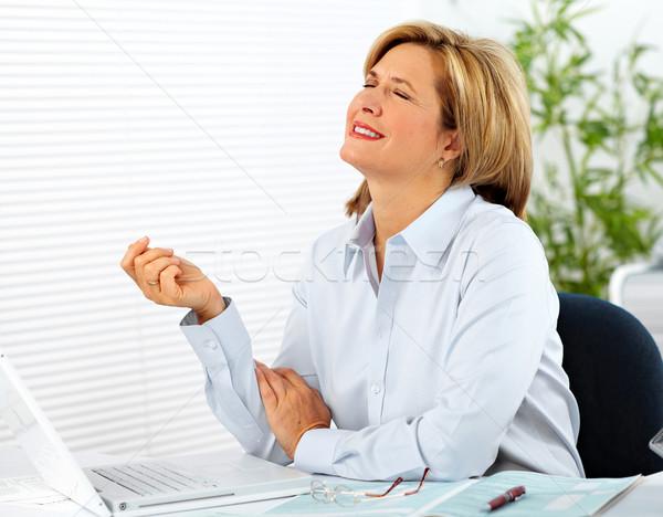 Business lady having headache. Stock photo © Kurhan