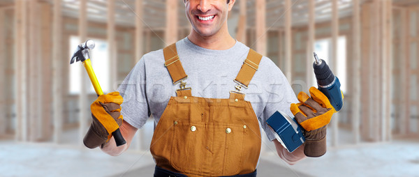 worker with drill and hammer Stock photo © Kurhan