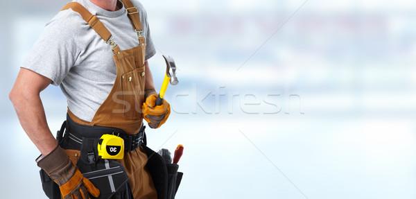 Construction worker with hammer Stock photo © Kurhan