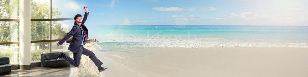 Businessman running on beach Stock photo © Kurhan