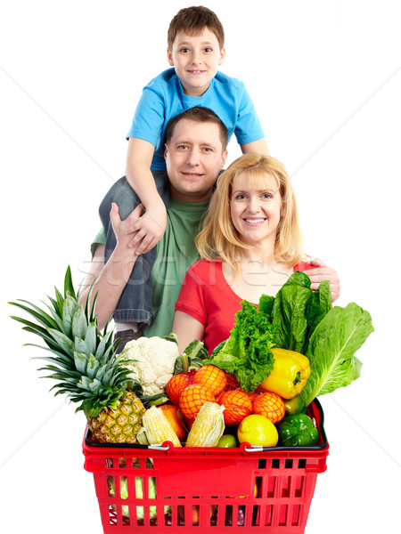 Happy family with a grocery shopping basket. Stock photo © Kurhan
