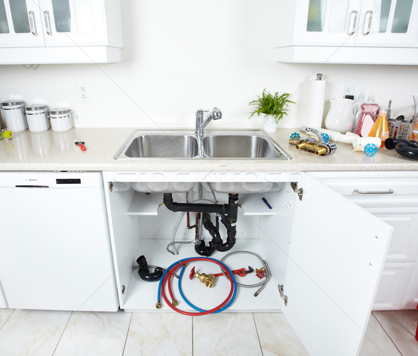 Kitchen sink pipes and drain. Plumbing. Stock photo © Kurhan