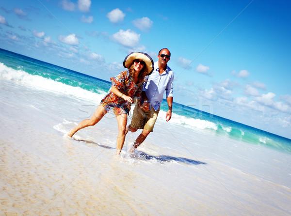 Loving couple relaxing on beach Stock photo © Kurhan