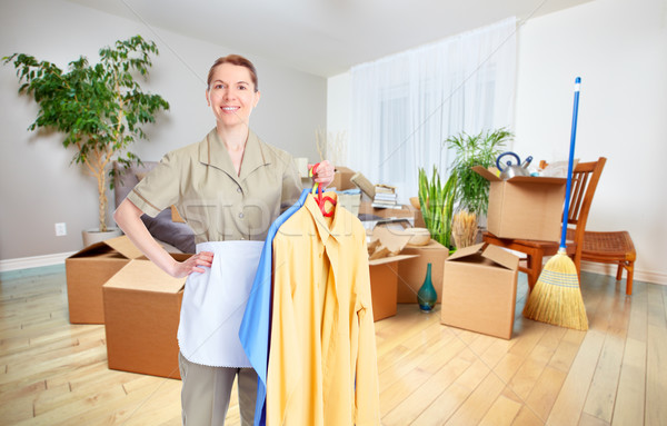 Maid woman with clothing. Stock photo © Kurhan