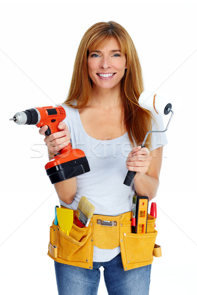 Woman with drill and paint roller. Stock photo © Kurhan