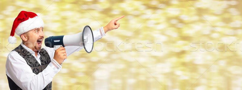 Santa man with megaphone. Stock photo © Kurhan
