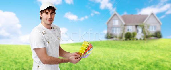 Painter near new house. Stock photo © Kurhan