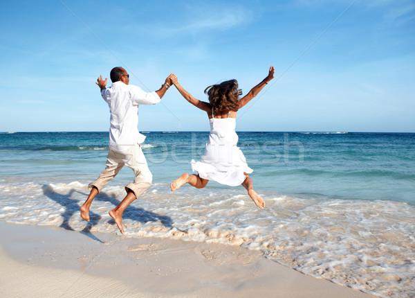 Foto stock: Feliz · Pareja · saltar · playa · vacaciones · de · verano · hombre