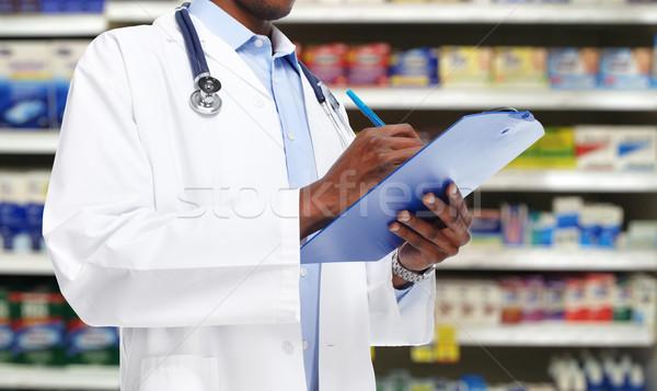 Eller siyah doktor adam mavi el Stok fotoğraf © Kurhan